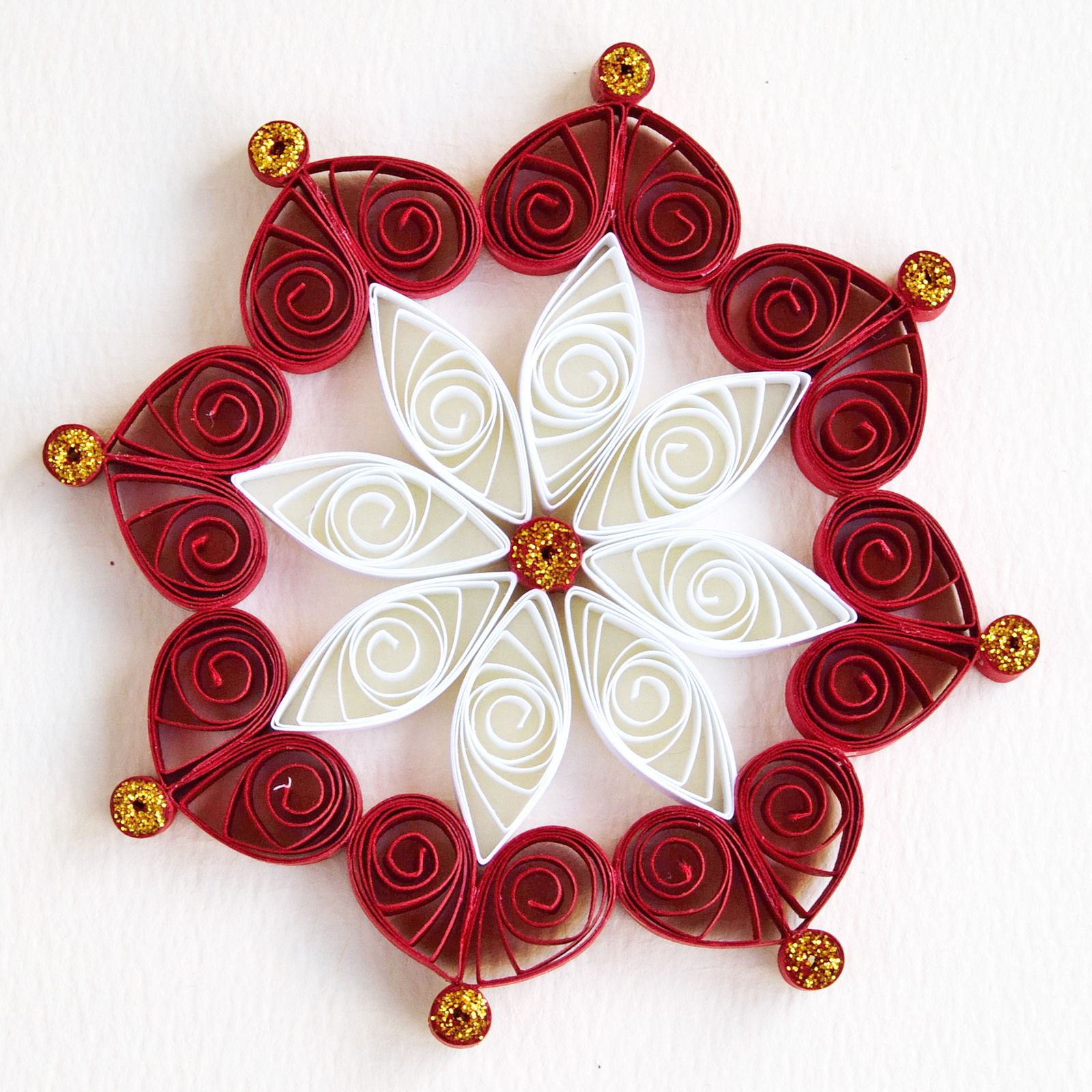 6 point red and white quilled snowflake with gold glitter for Quilling strips designs