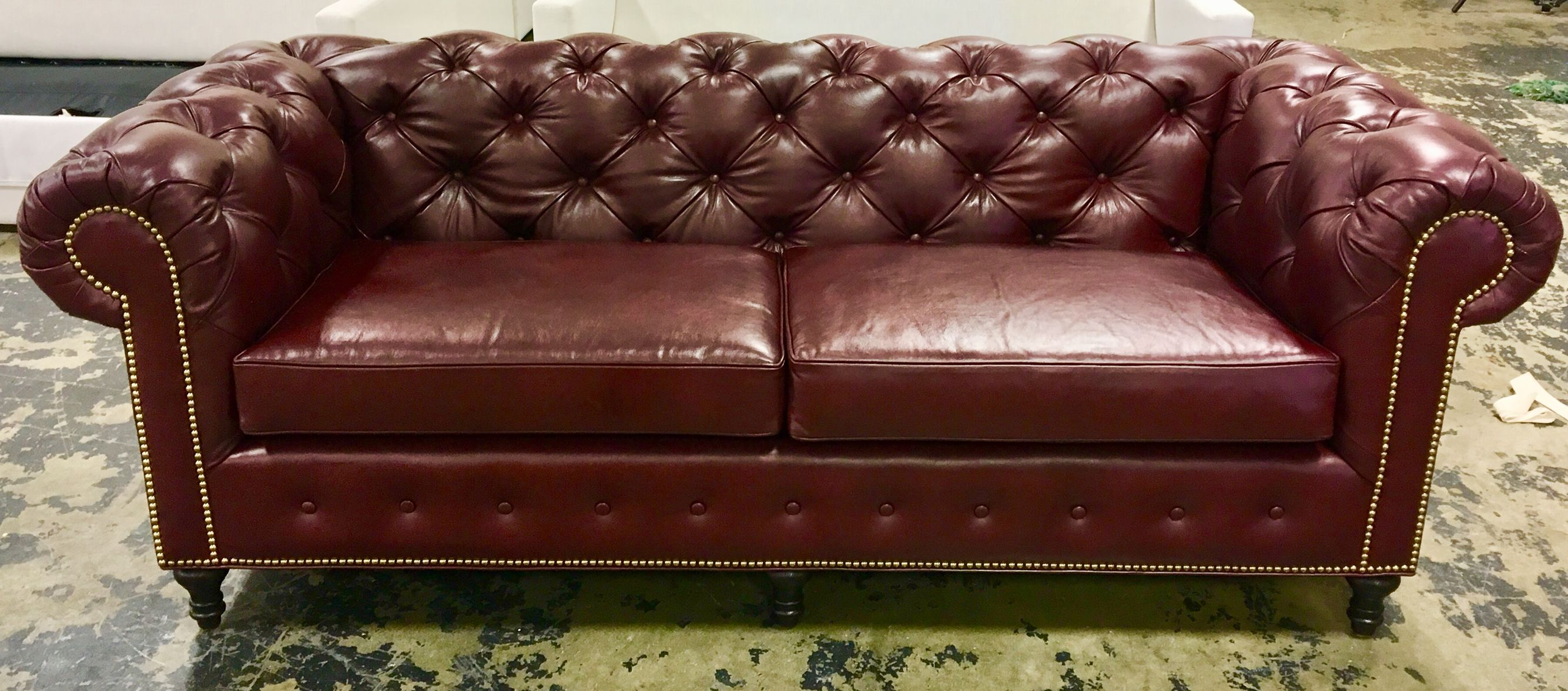 Amazing tufted sofa with nailhead trim executed to