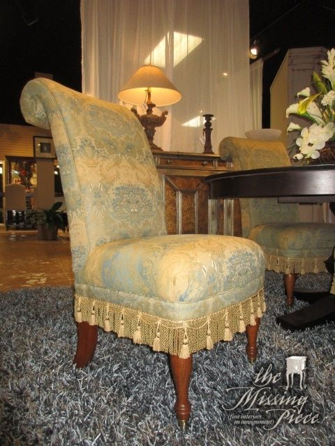 """Set of four Drexel parsons chairs in a gold and blue print upholstery. These chairs have a rolled back and a lovely tassel skirt! Just perfect for a formal dining room. Each chair is 22""""wide x 30""""deep x 42""""high.  Arrived: Tuesday January 17th, 2017"""