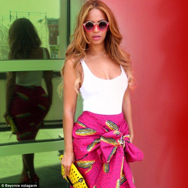 Beyonce shows off her toned figure in summery skirt in