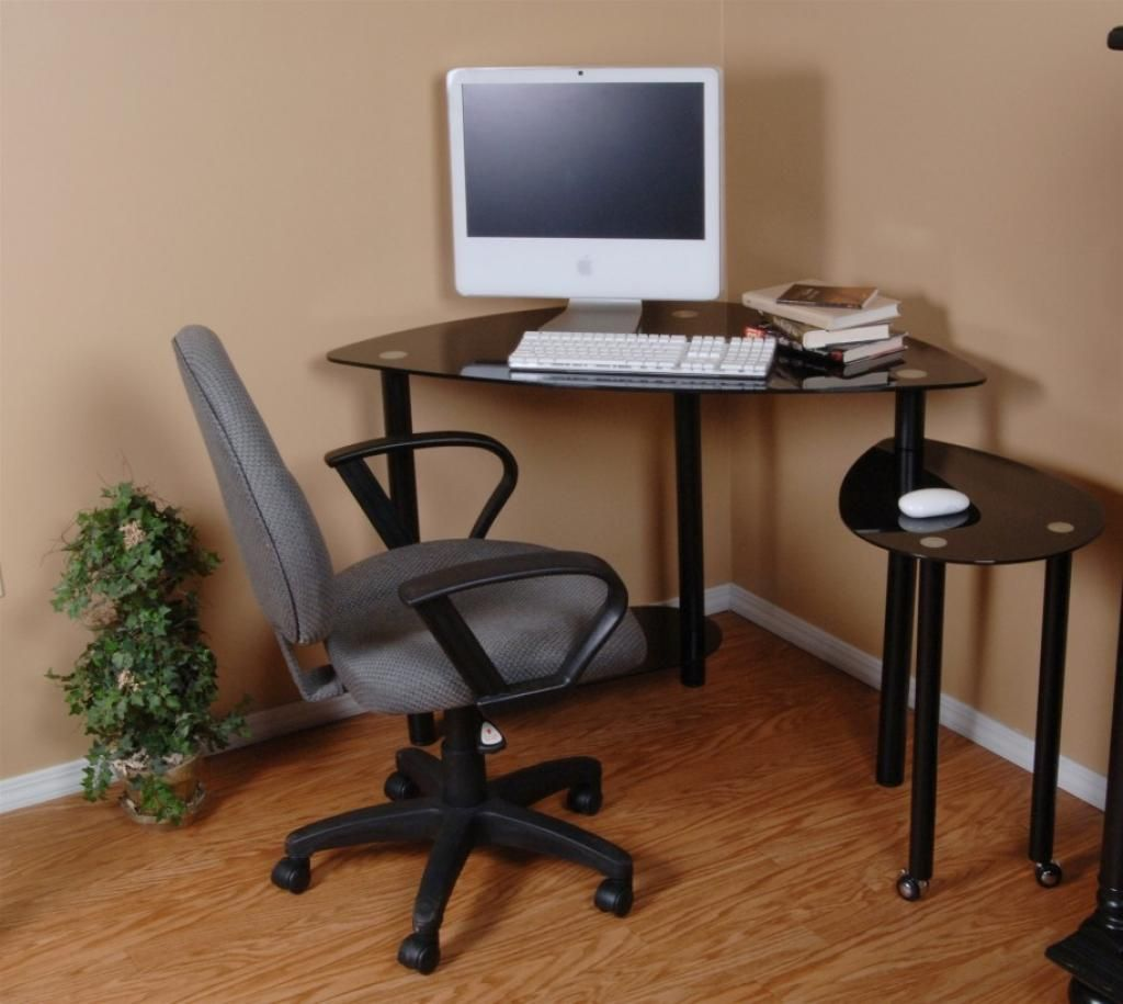 Small Glass Computer Table On Corner With Brown Laminate Wood Fl