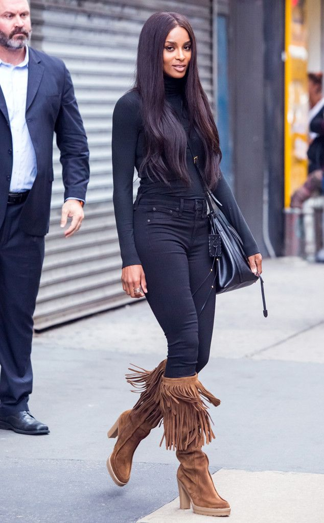 All About The Boots from Ciara's Street Style Nothing quite updates an all-black outfit like a pair of statement boots! Ciara chooses these brown fringe Ralph Lauren versions for the occasion.