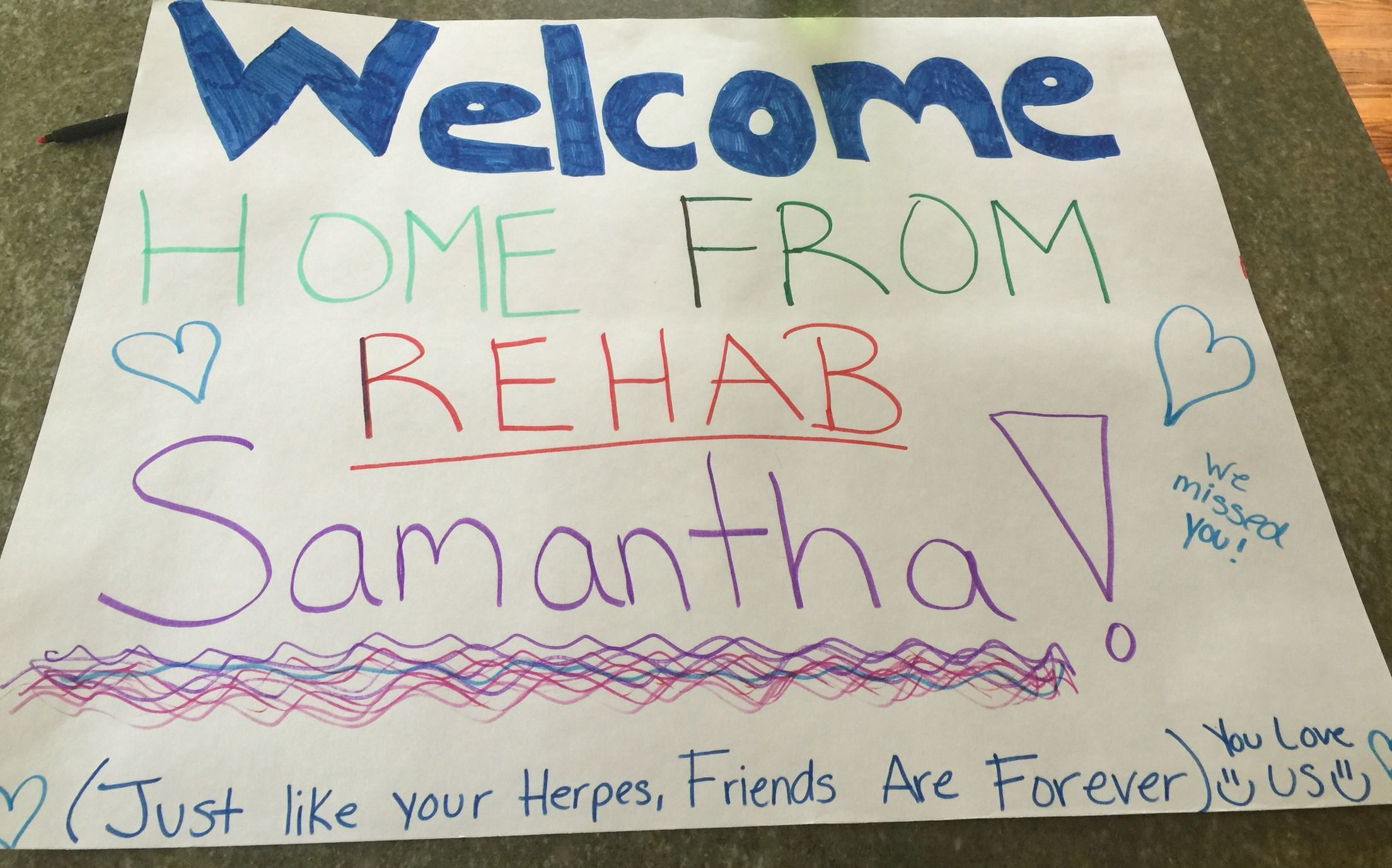 Funny welcome home airport sign! (Of course with a bottle of wine in ...