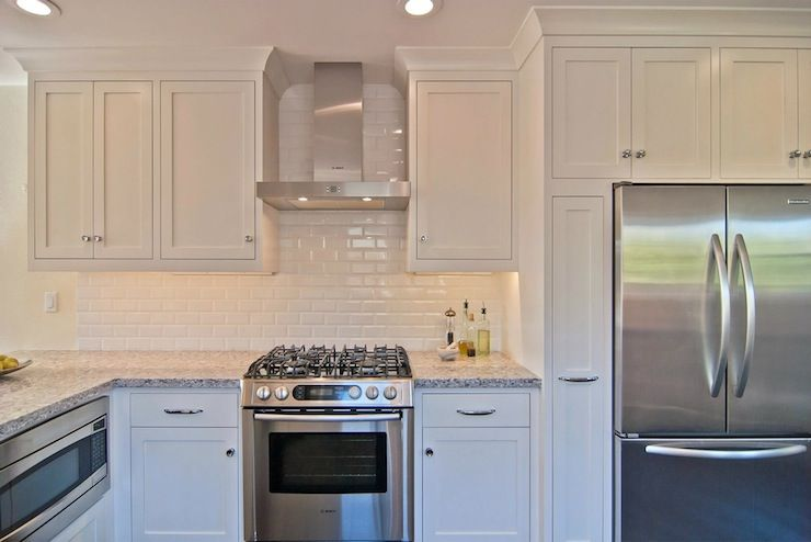 William adams design all white kitchen design with shaker for Shiny white kitchen cabinets