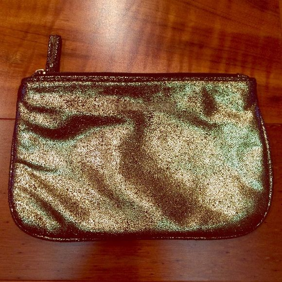 Victoria's Secret makeup bag Beautiful gold Victoria's Secret cloth makeup bag. Victoria's Secret Bags Cosmetic Bags & Cases