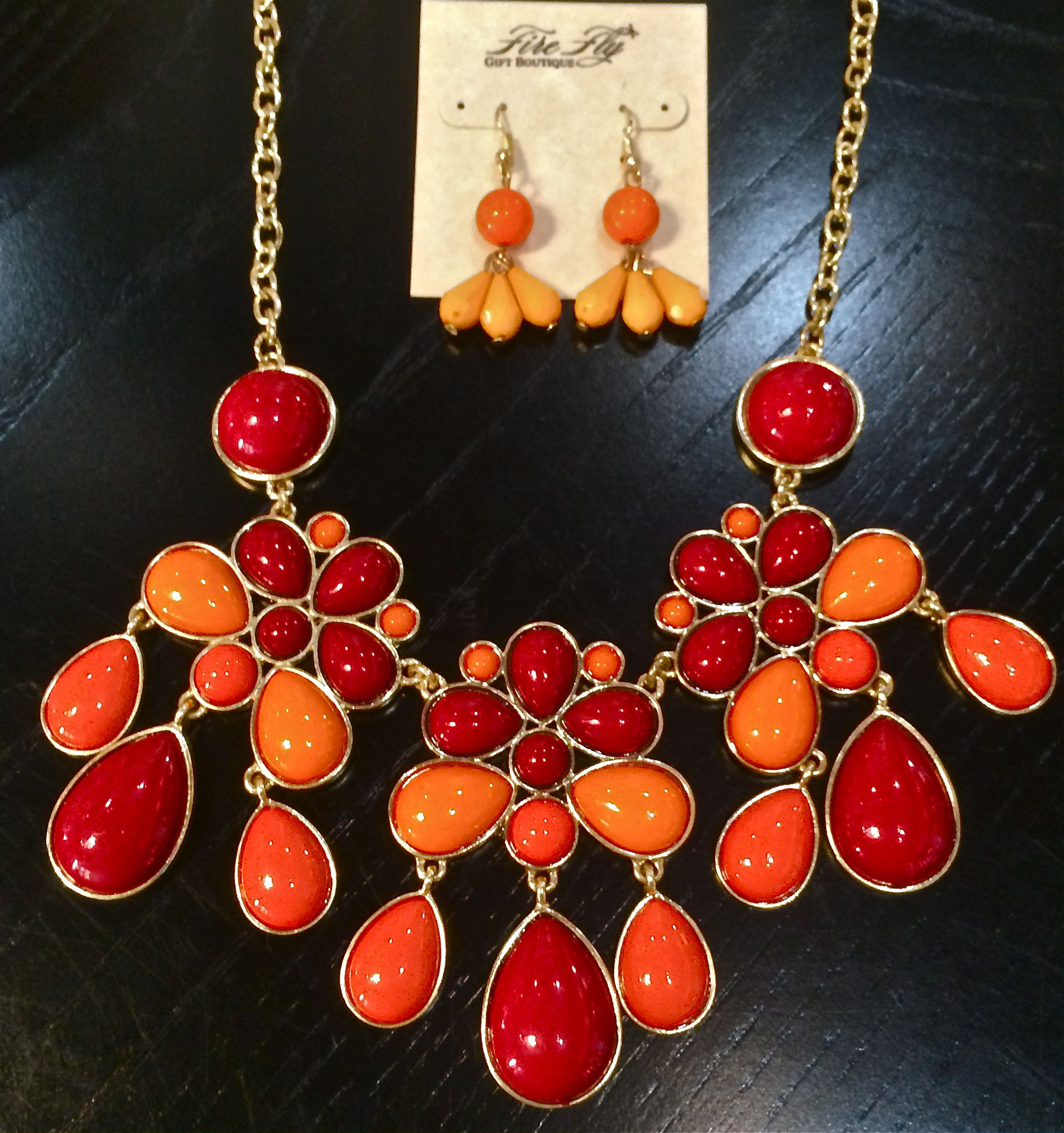 Shades of orange and red!  Mix with your favorite t-shirt or dress...