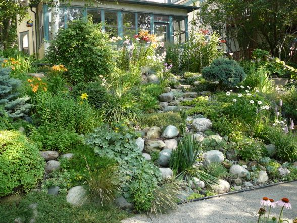 Mn The Front Hillside Rock Garden Features Two Small Ponds