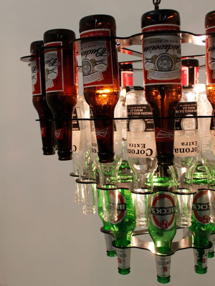 Save your empty bottles and put them to good work heres one cool heres one cool idea a 3 tiered beer bottle chandelier by chantelle lighting get bottle lamp wiring kits and tutorials to make your aloadofball Gallery