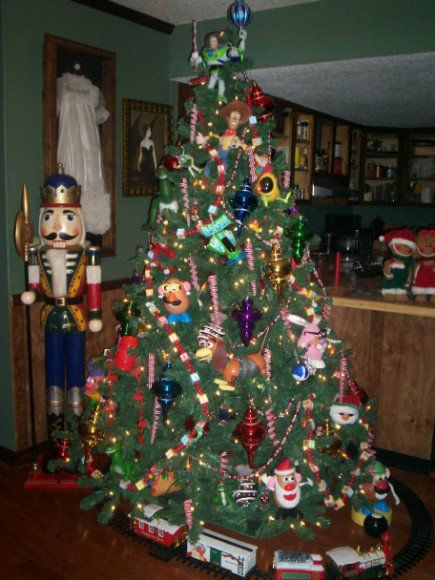 Toy Story Themed Tree Done With Toys Picked Up In Garage Sales Christmas Decorations Christmas Tree Decorations Holiday