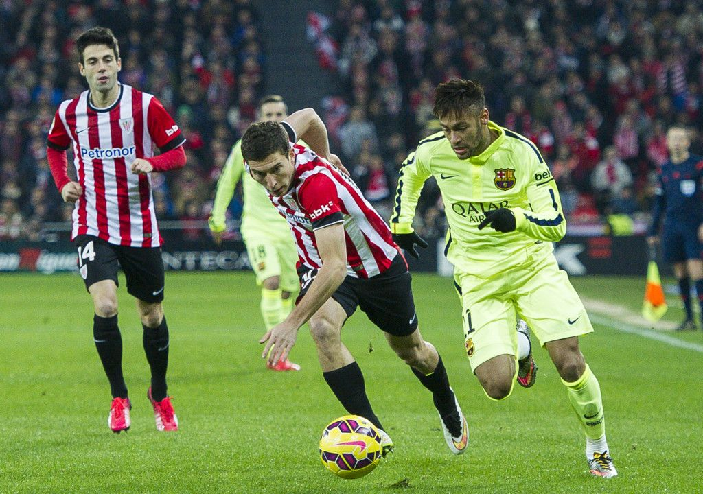 Neymar of FC Barcelona duels for the ball with Oscar De Marcos of Athletic Club during the La Liga match between Athletic Club and FC Barcelona at San Mames Stadium on February 8, 2015 in Bilbao, Spain.