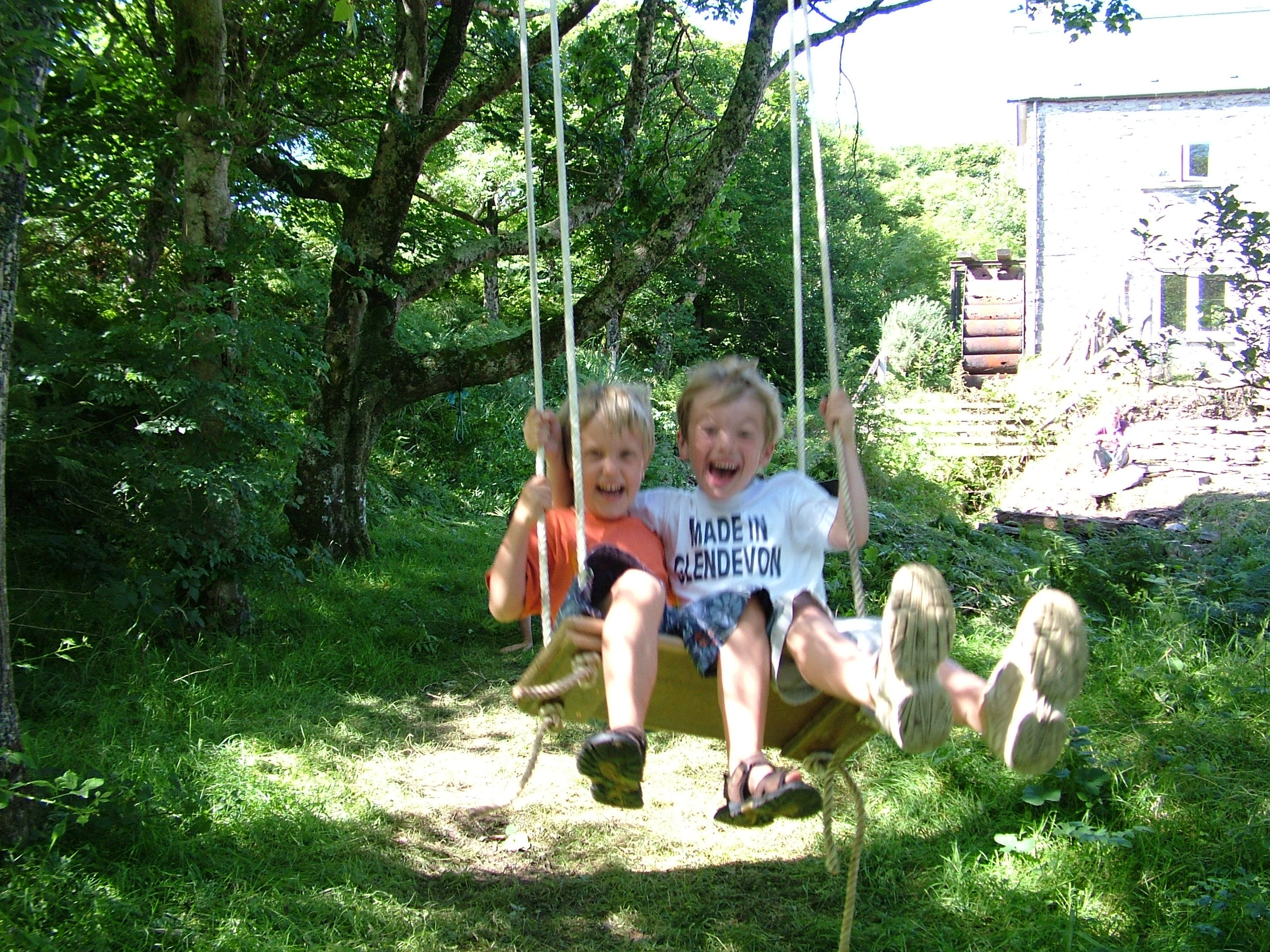 Crazy capers on the swing in the garden of the old mill on the isle