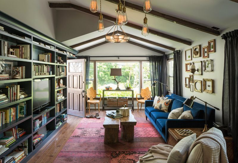 Actor Ian Harding and artist Sophia Hart's personalities shine in a house nestled in the trees. Eclectic Living Room by Shannon Ggem ASID