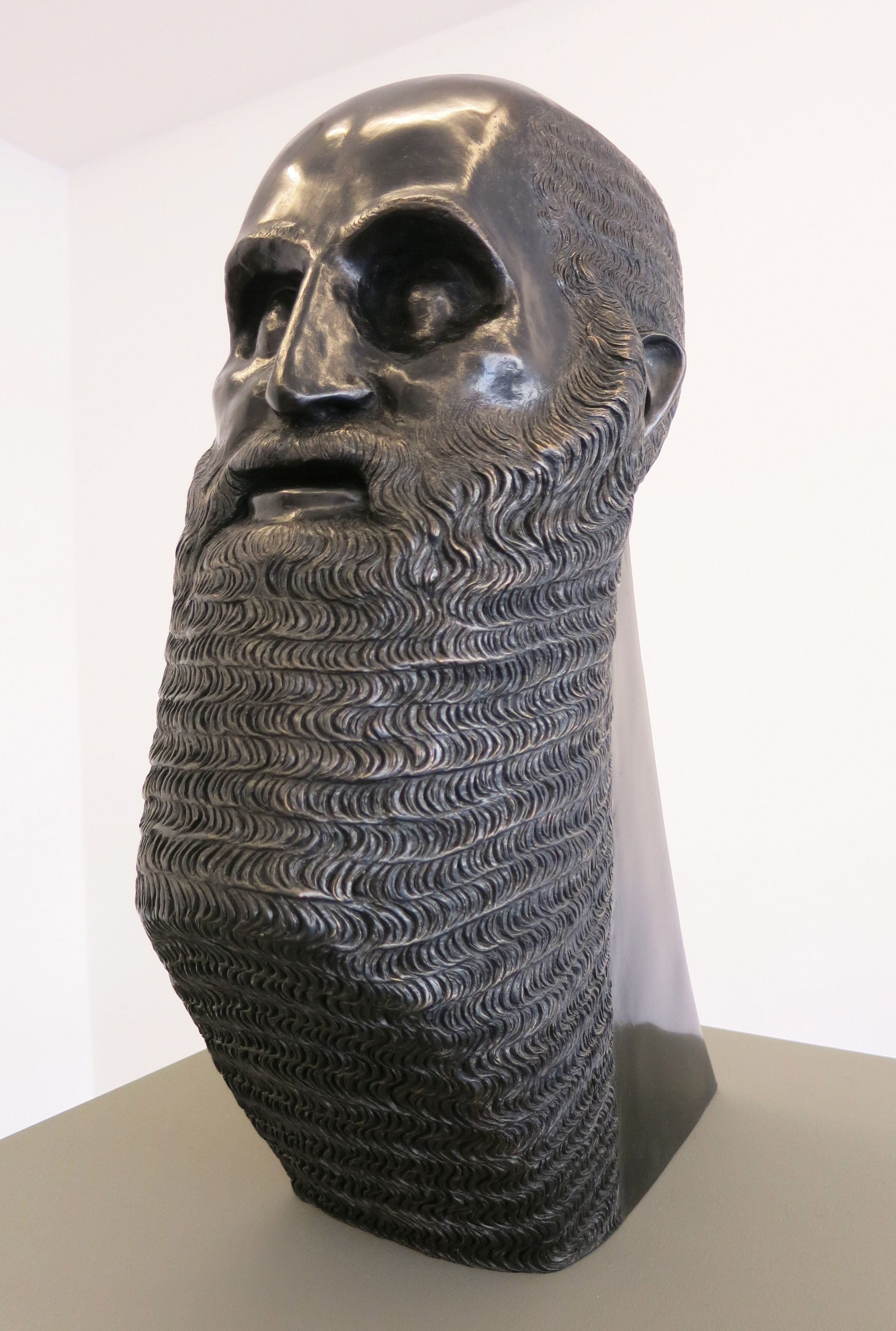 Saying her art practice is about 'mistranslating the history of ancient objects,' Brooklyn-based sculptor Sarah Peters 'misinterprets' Akkadian rulers, Greek busts and more with stunning results in several bronze heads at LES gallery Eleven Rivington. (Through May 17th).Sarah Peters, Portrait of a Bearded Man with Triangular Base, bronze, 17.5 x 7 x 13 inches, 2015.