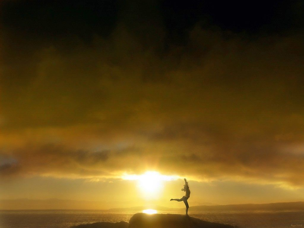 Doing yoga under a sun-sational sun.