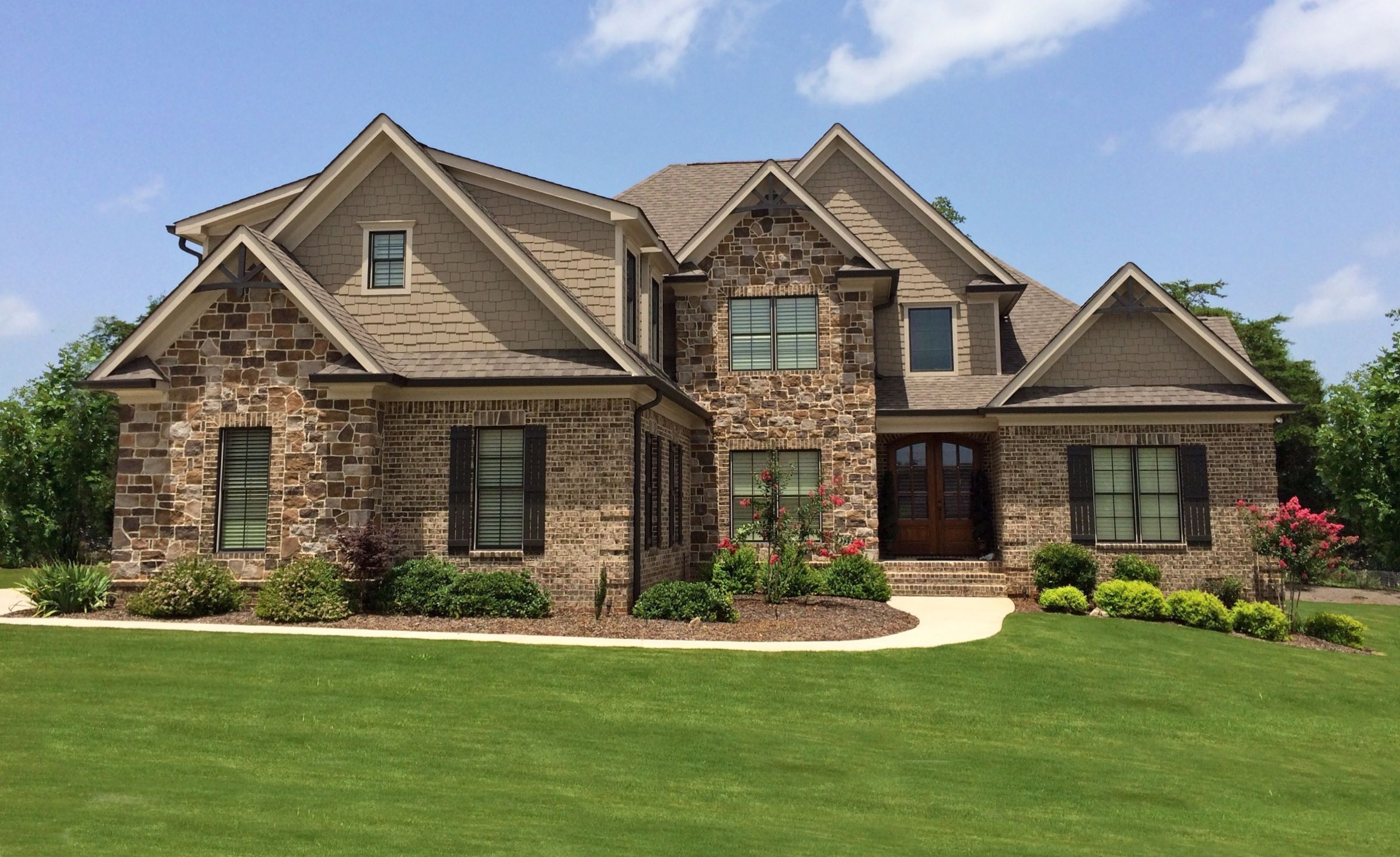 Two Story Home with Brick and Stone Exterior | Stone ...