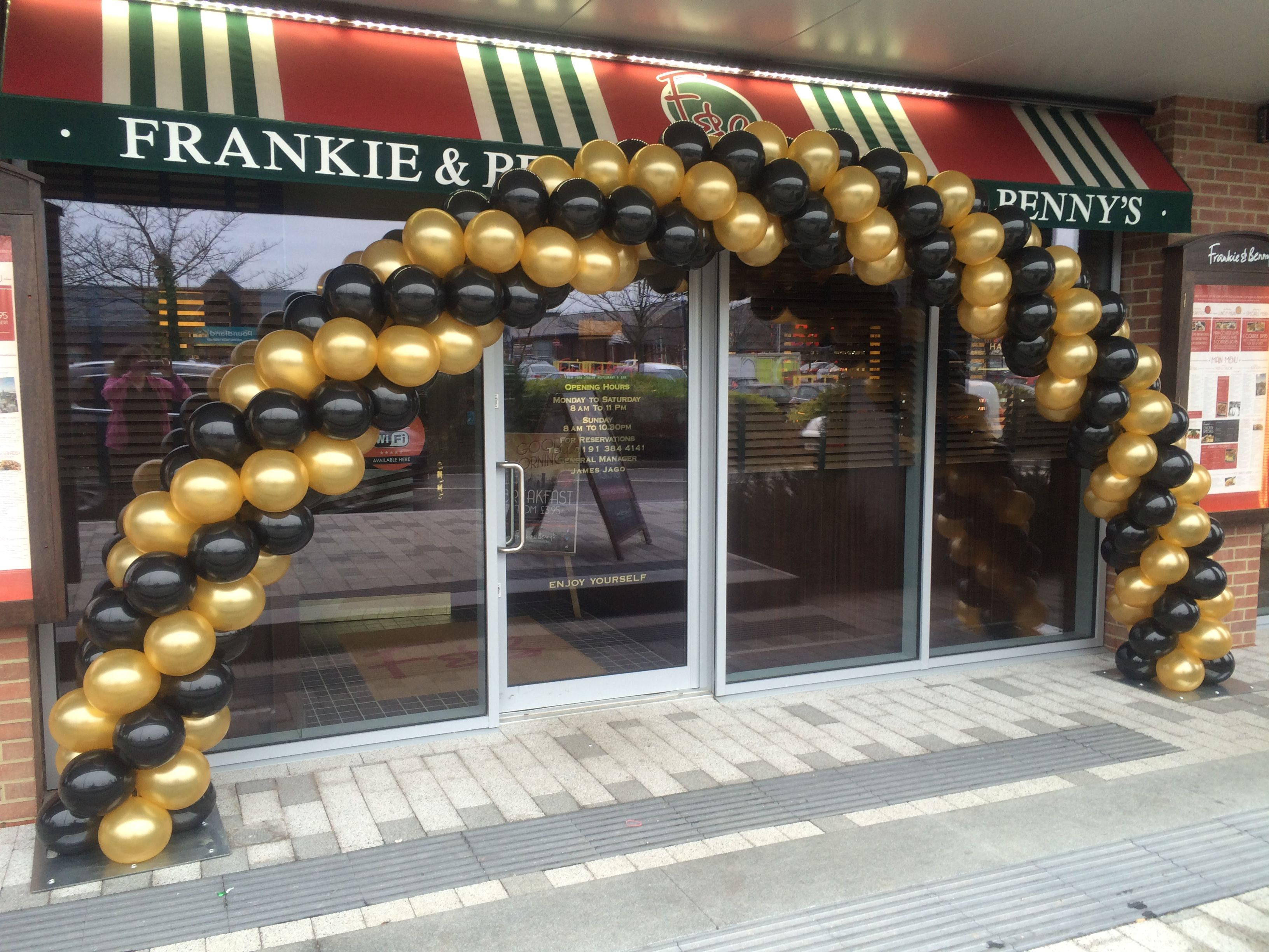 Black And Gold Swirl Garland Arch To Draw Attention To The Opening Of A New Restaurant Balloons Balloon Decorations Black Balloons