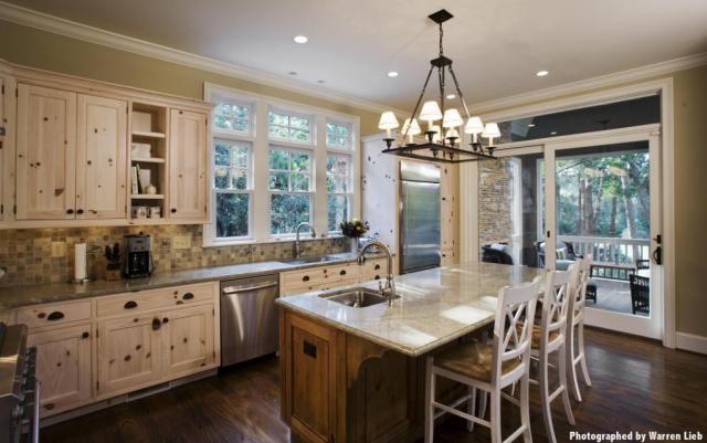 similar color scheme - ivory cabinets, slate backsplash, lighter granite, and pale yellow walls  - via Kitchen 48 @ wcprirchard.com