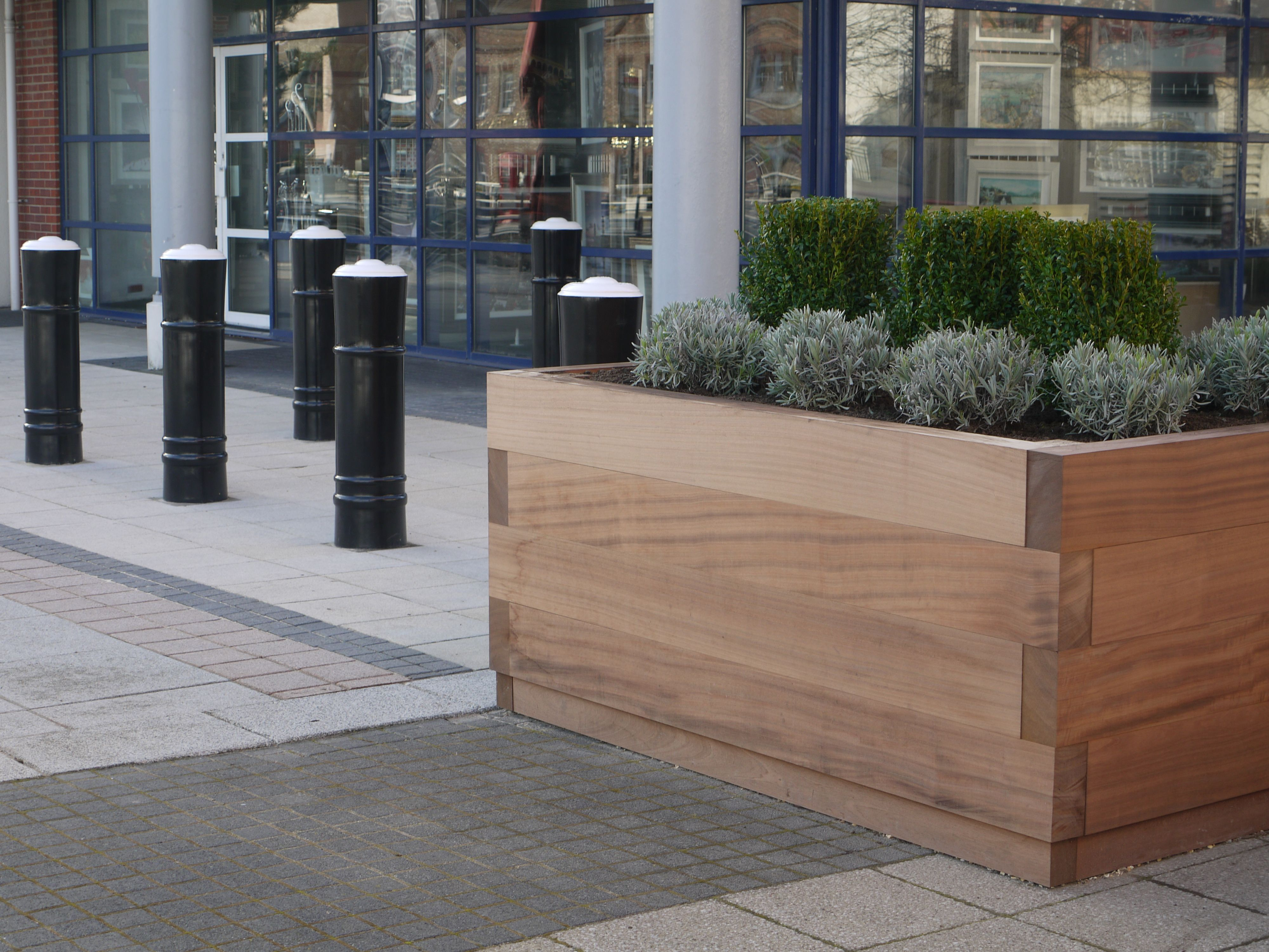 The Bespoke Ct Block Timber Planters Tie Into The Surrounding