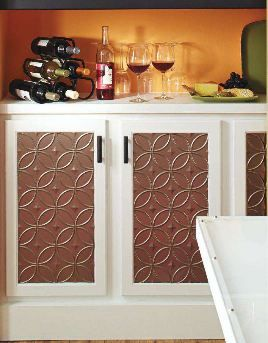 Use ceiling tiles to update blah cabinet doors.  From DIY magazine.
