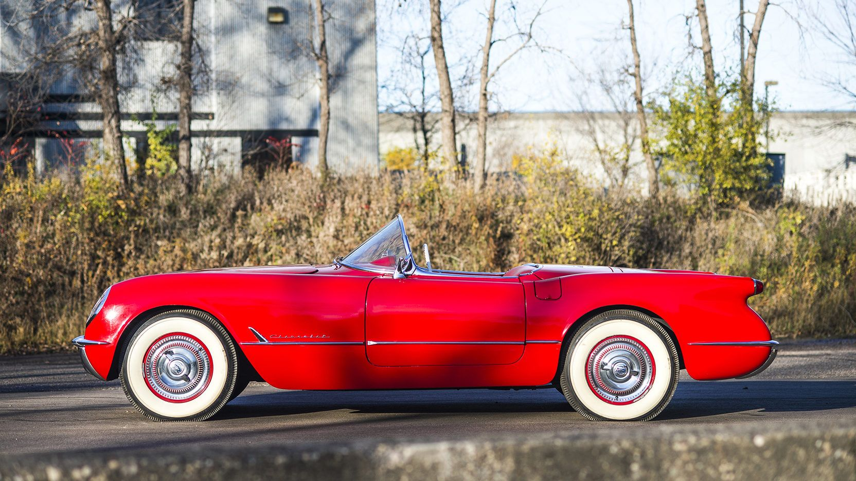 This 1954 convertible is sitting on BF Goodrich Silvertown Wide Whitewall tires and has the full size spinner wheel covers. What a sharp Corvette!