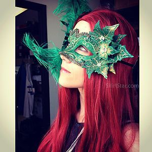 Green and gold Poison Ivy costume Venetian masquerade mask with leaves, rhinestones, brocade, and feathers.  Found at www.skirtstar.com