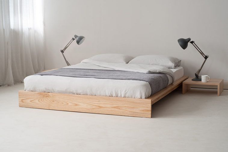 Japanese Platform Bed With White Bedding And Small Side Table With