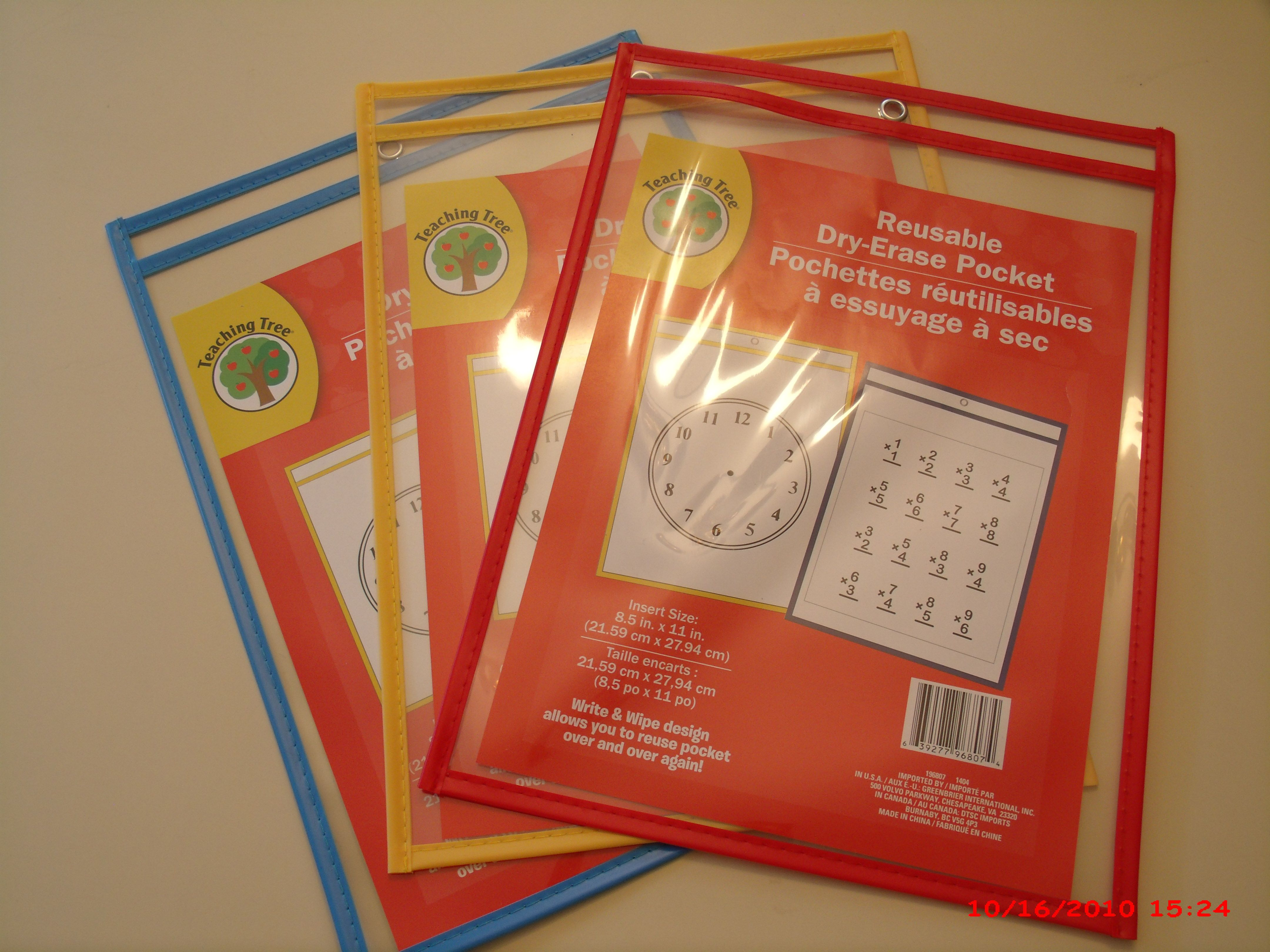 Insert papers in the dry ease wipe and write pages. $1.00 each.