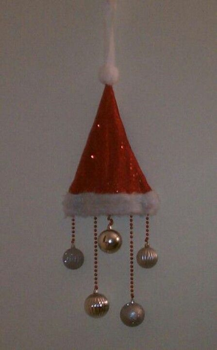 Another cute, Christmas door decor! Jistba Santa hat, cheap ornaments and beads!