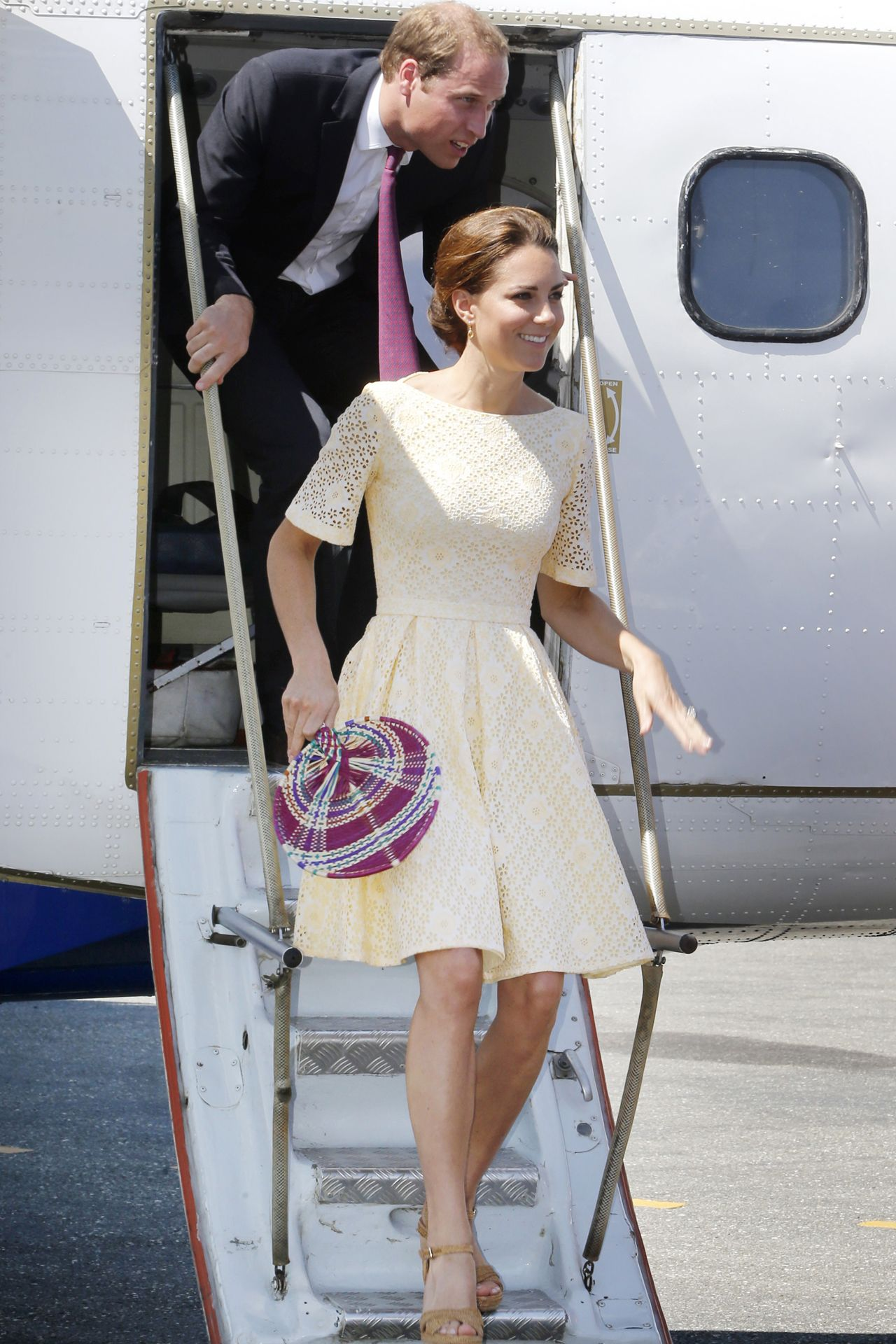 SEPTEMBER 18 2012 - A primrose yellow dress and a patterned fan were the Duchess' style choices for the last leg of her Diamond Jubilee tour with Prince William - on the islands of Tuvalu.