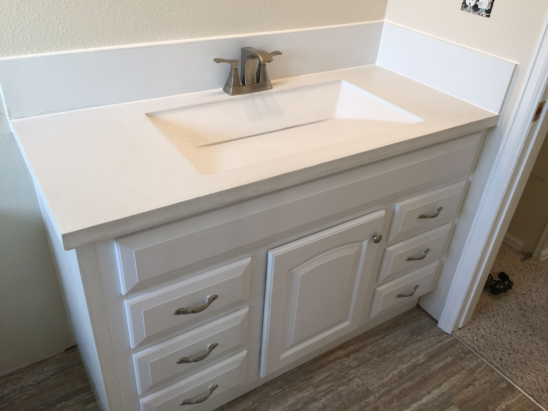 Custom Built White Concrete Countertop With Integrated Sink And Slot Drain Features 6 Backsplash Side Panel