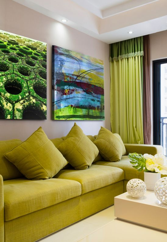 Green living room with matching photograph and abstract painting via ...