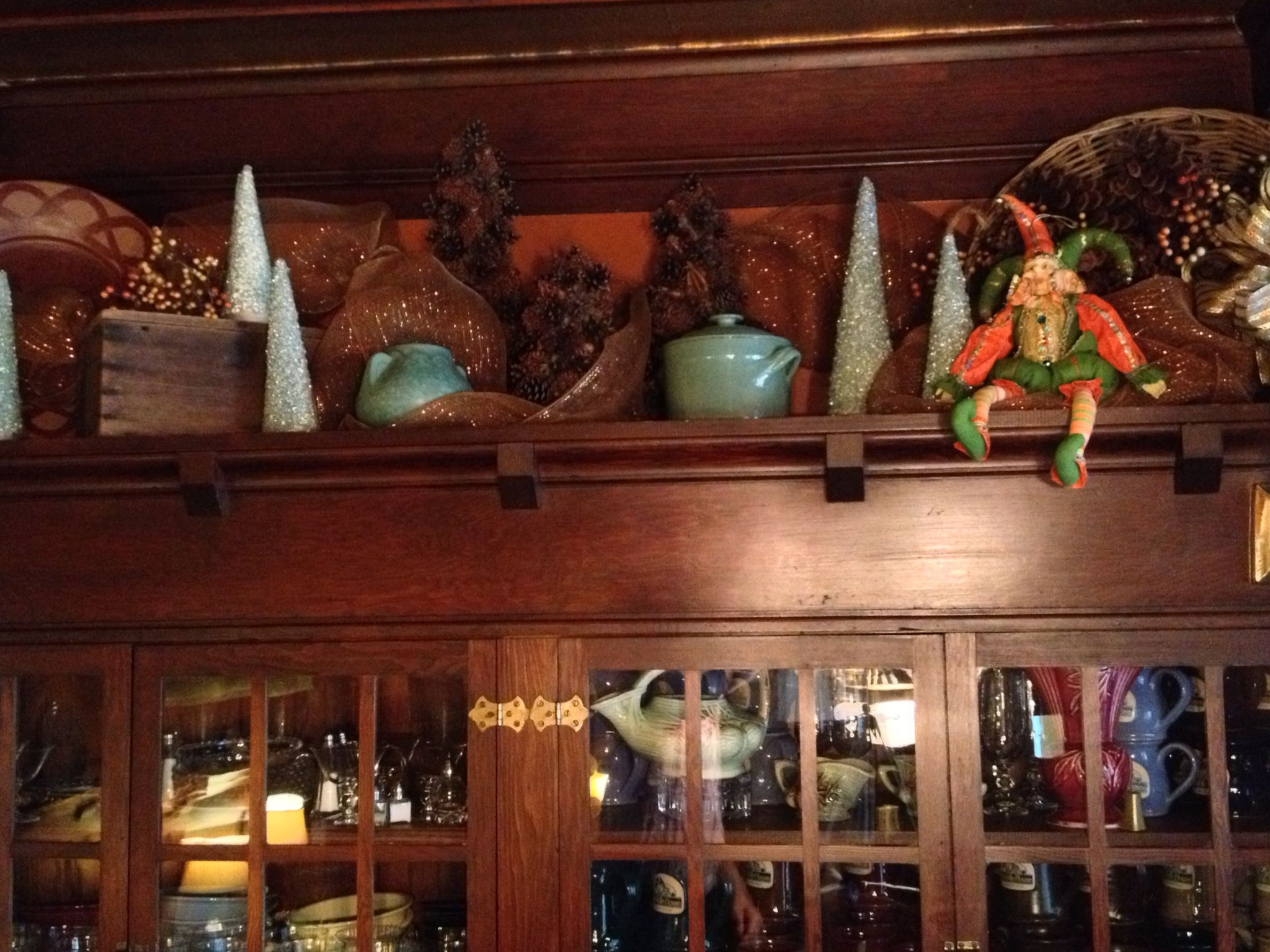 Holiday decorations on top of the built in buffet in the