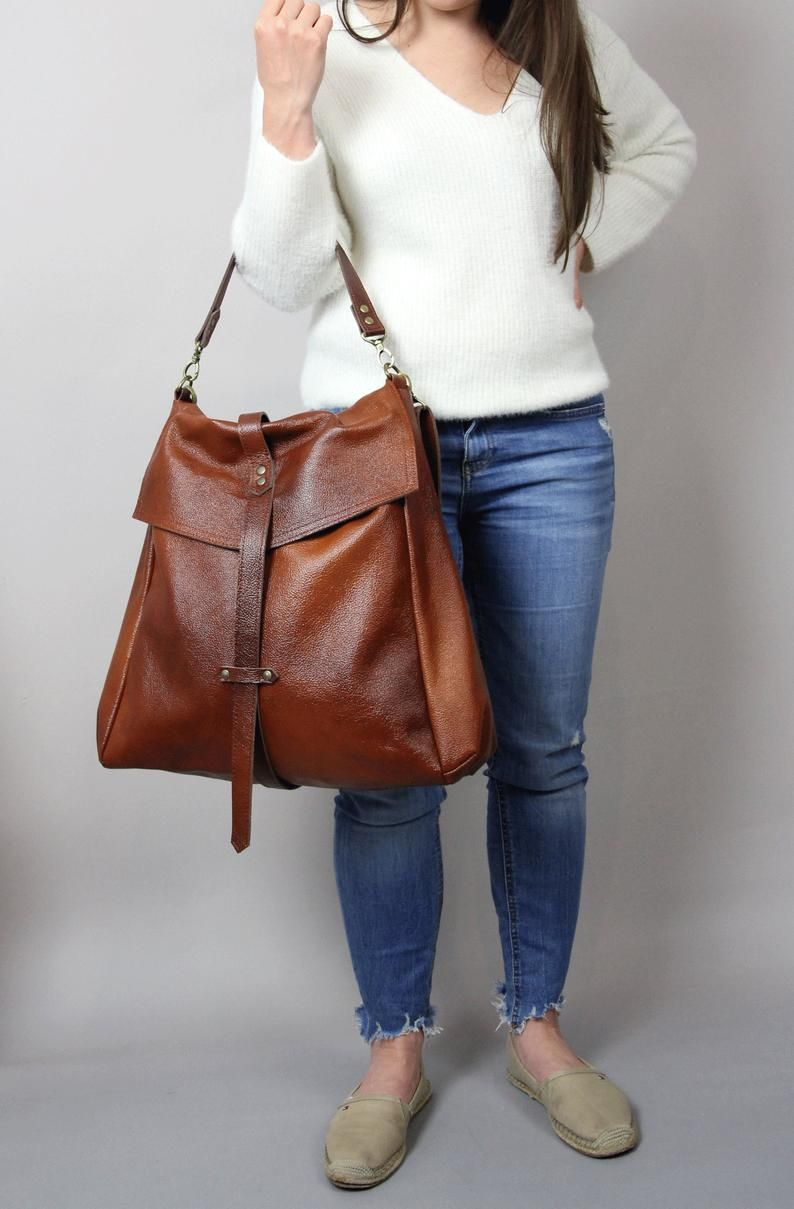 Leather Large Travel Bag that Can Convert to a Backpack Fringed Free Shipping.