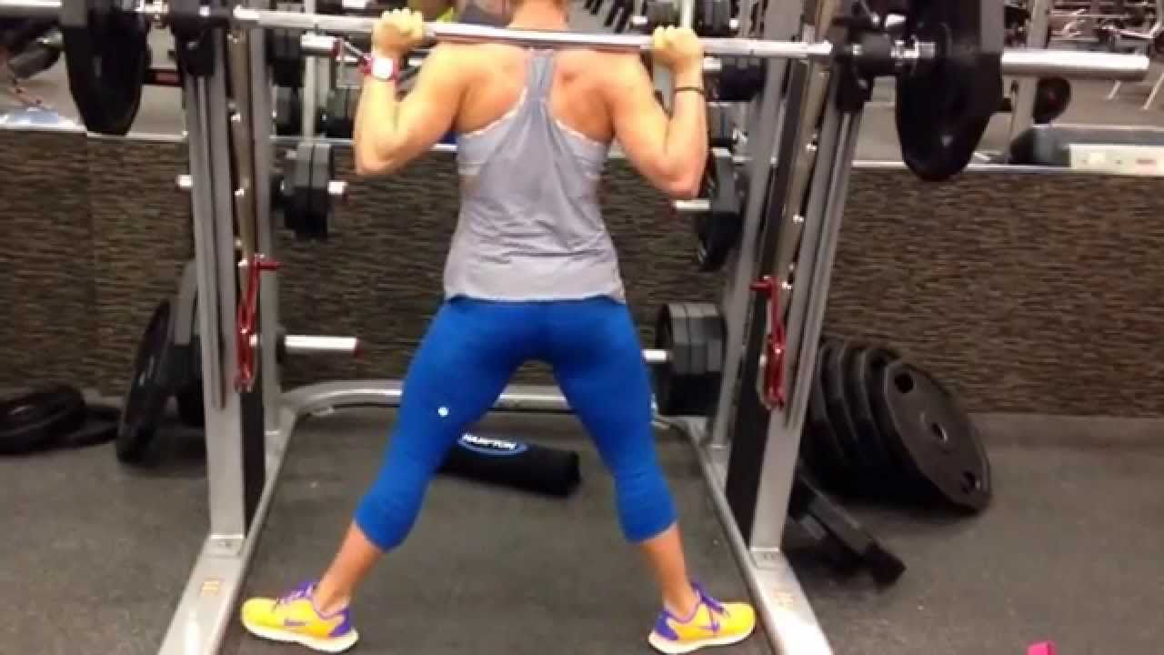 Samantha Belbel doing wide stance and narrow stance squats on smith machine