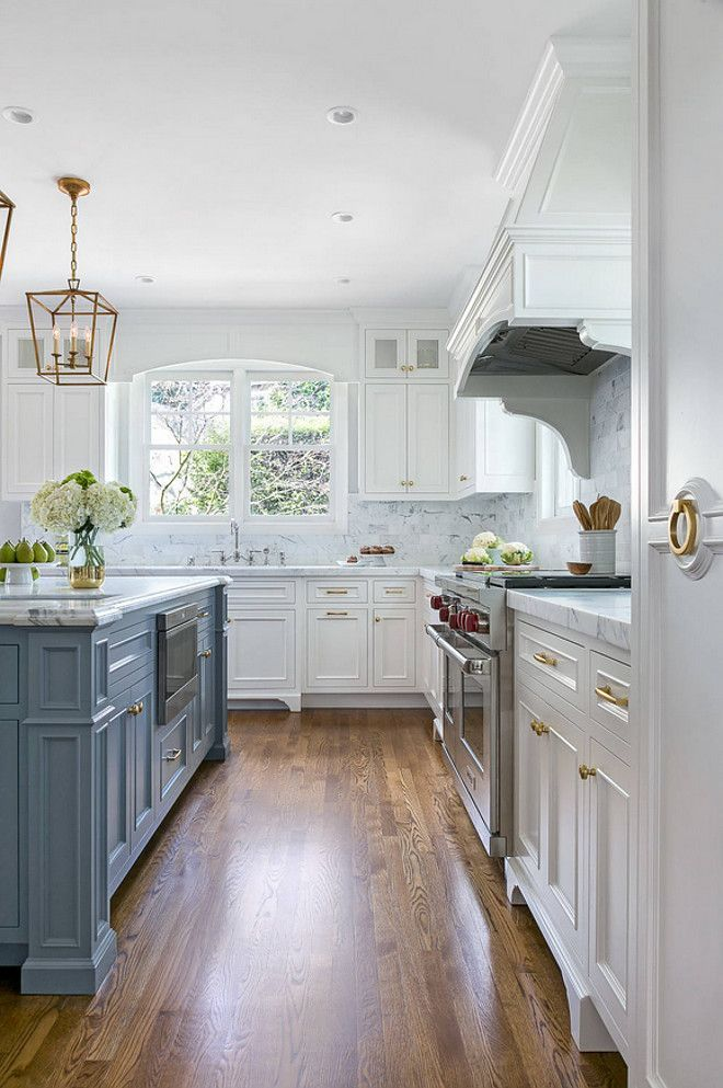 White Kitchen with Stacked Cabinets and Grey Island | home ...