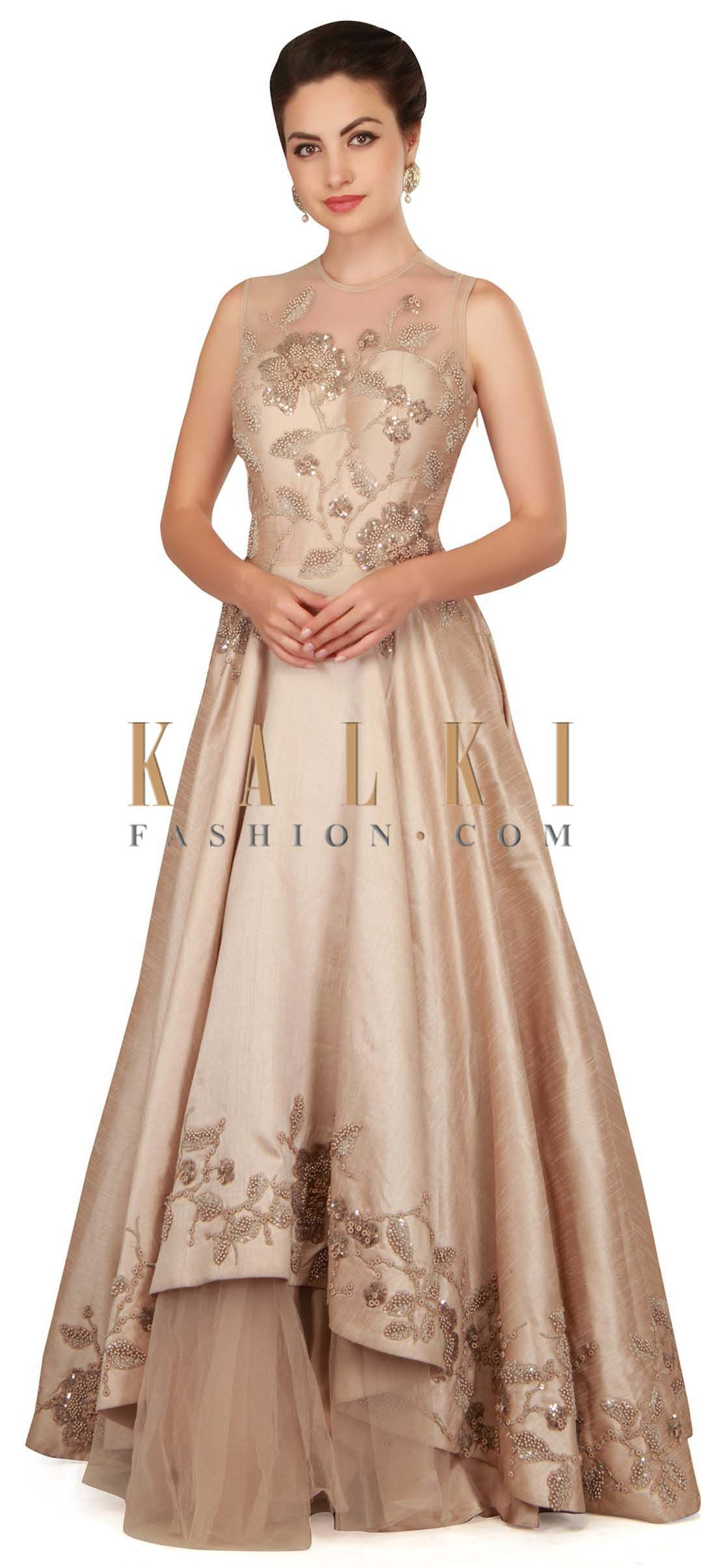 Dull cream gown with bodice and yoke in pearl work only on Kalki ...