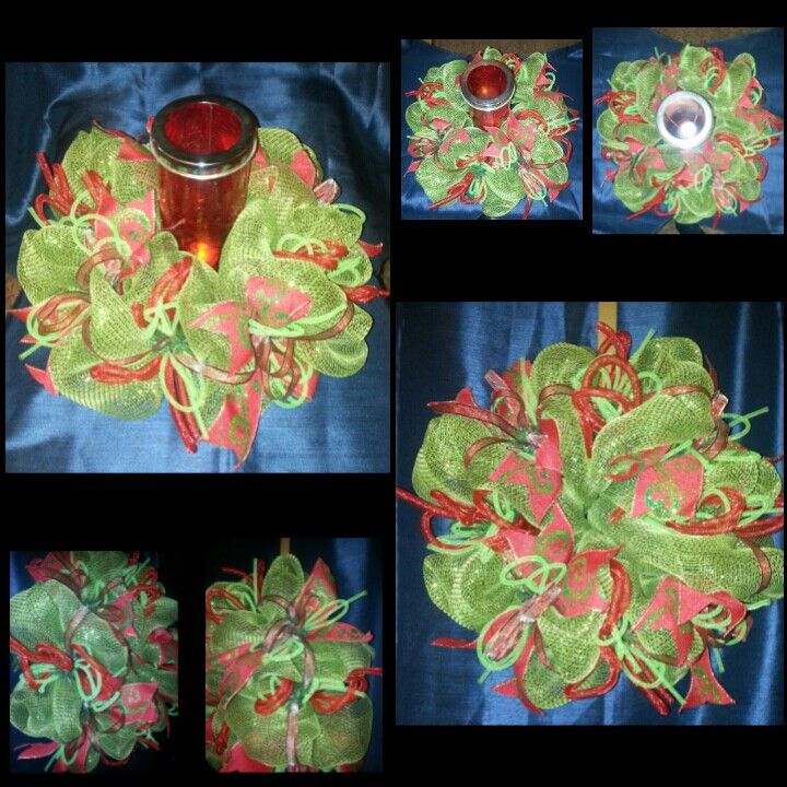Green mesh Christmas Wreath with 2 inch wired red with green ribbon and green and red mesh tubing.   Red wired ribbon accents.  Use as a door/walk hanging or place a candle or vase in center and use as a center piece for your table.