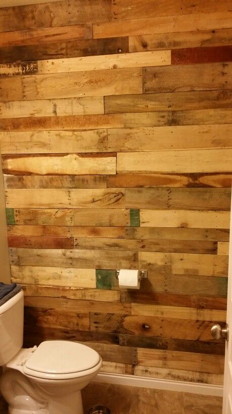 bathroom wall paneled in old pallet wood  bathroom wall