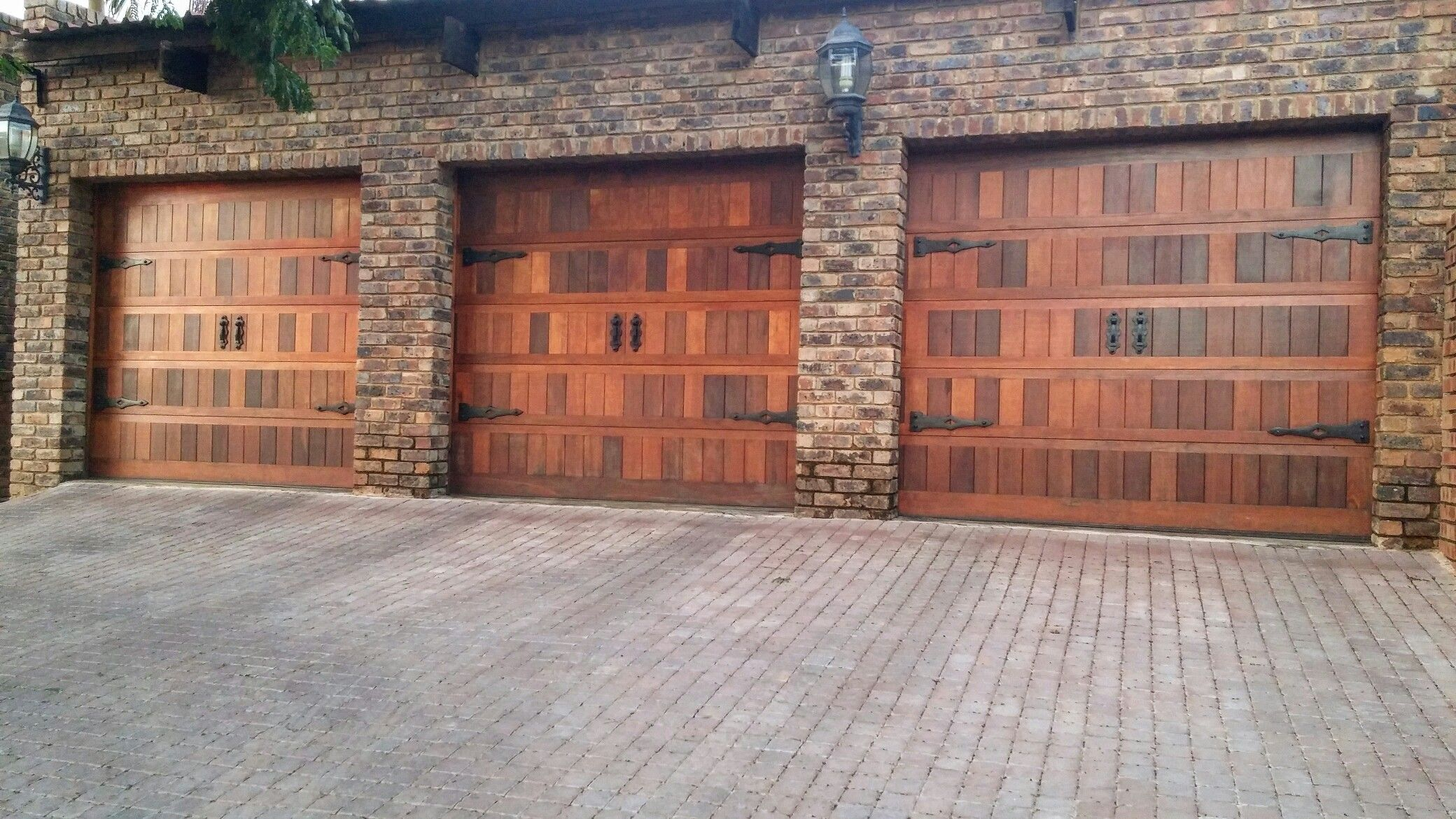 3 single garage doors with mock hinges and handles  Visit -  www.doorstuds.com