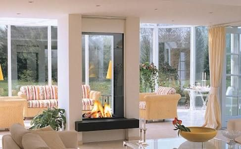 Double Sided Gas Fireplace With Tall See Through Panels Double