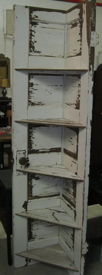 lovely idea reusing an old door for shelving i am not sure where this picture originated though. Black Bedroom Furniture Sets. Home Design Ideas