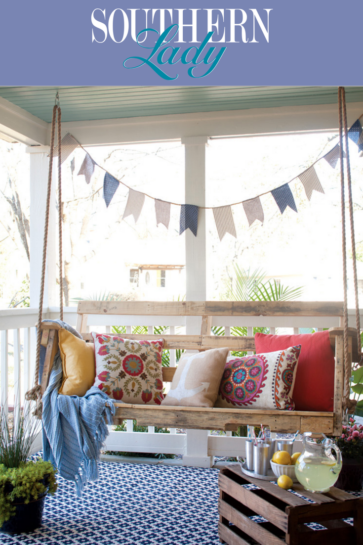 a reclaimed wood porch swing is dressed up with printed on porch swing ideas inspiration id=22875