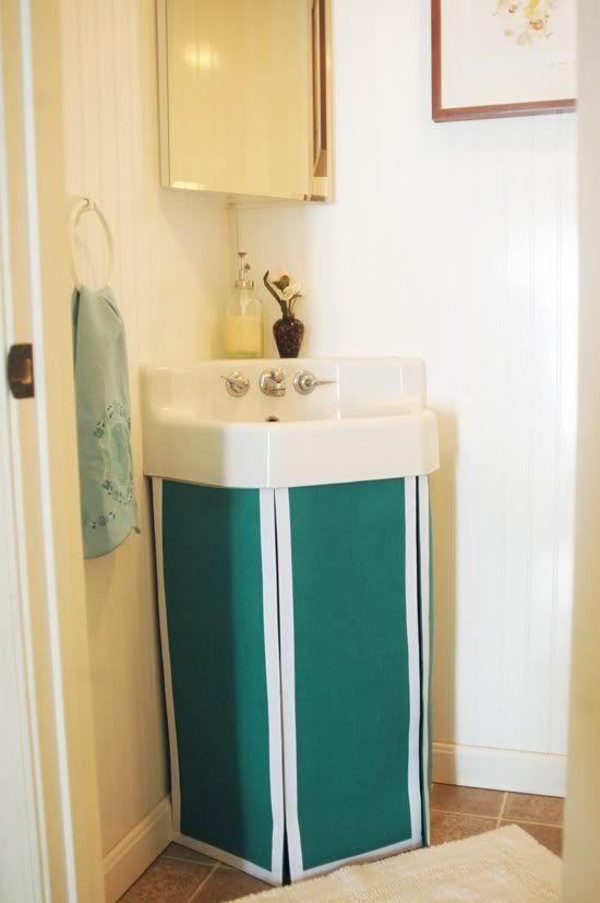 Small Bathroom Corner Sink With Emerald Green Fabric Skirt