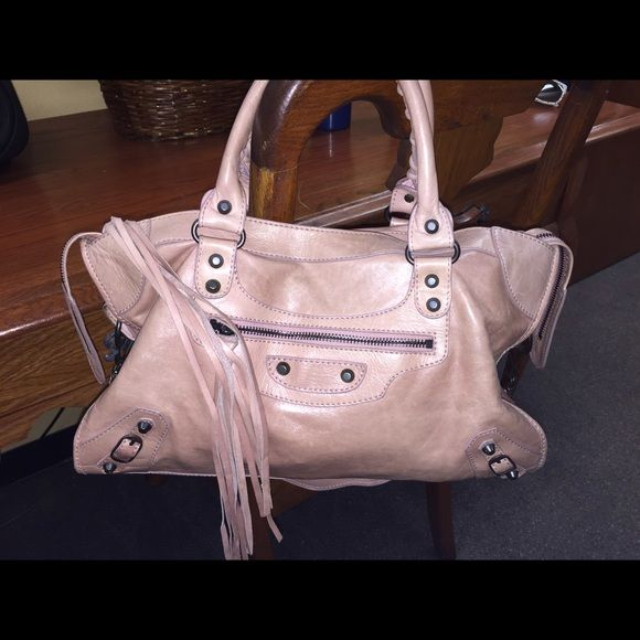 Balenciaga Nude Balenciaga Motorcycle bag!! It is in pristine preloved ❤️ condition, as you can see bag changes color w the flash of the camera, u would say it's like a nude color, perfect for the spring, will consider reasonable trade and open to offers!!! Balenciaga Bags Totes