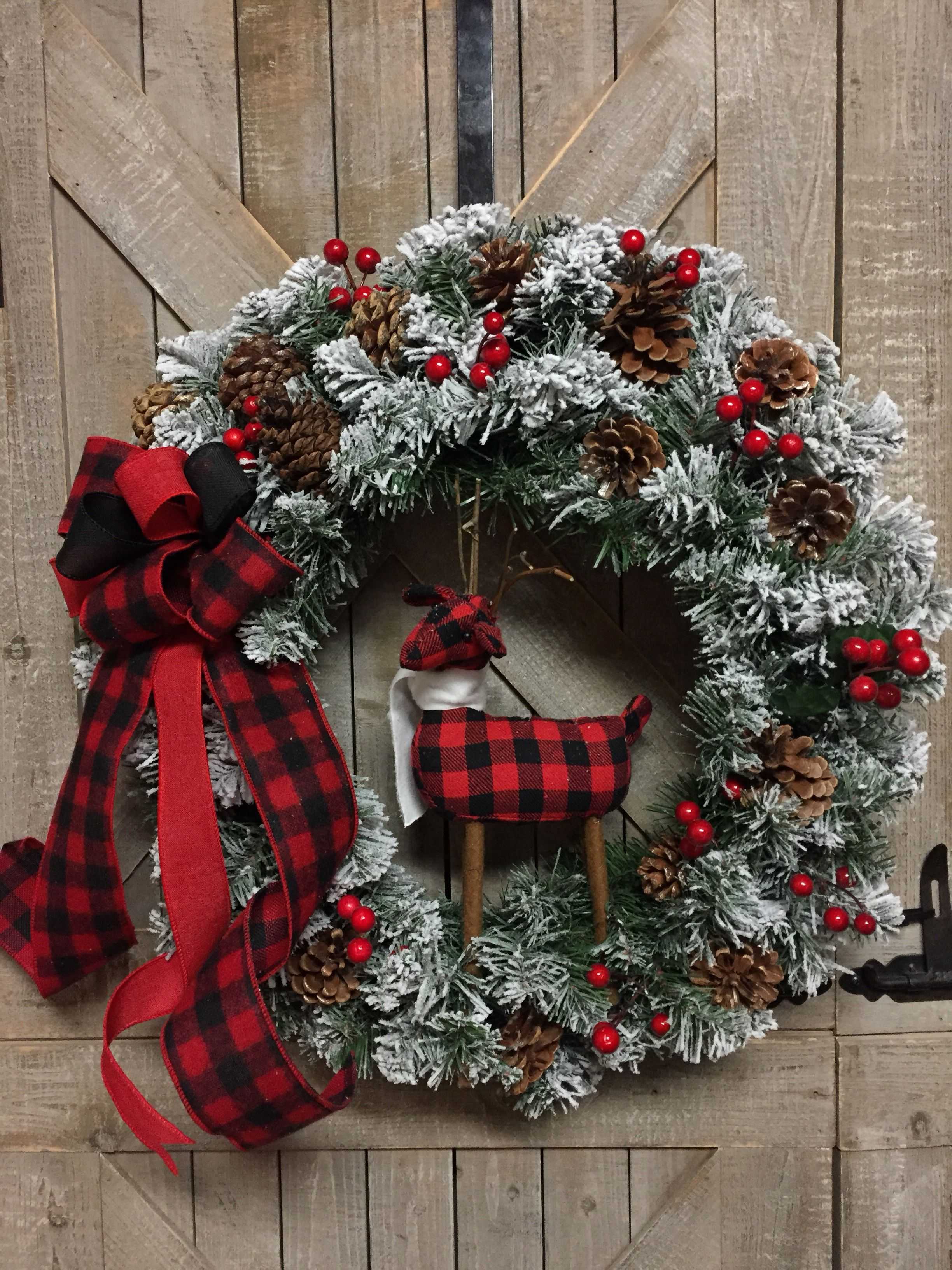 Buffalo check reindeer on faux evergreen with berries & pine cones