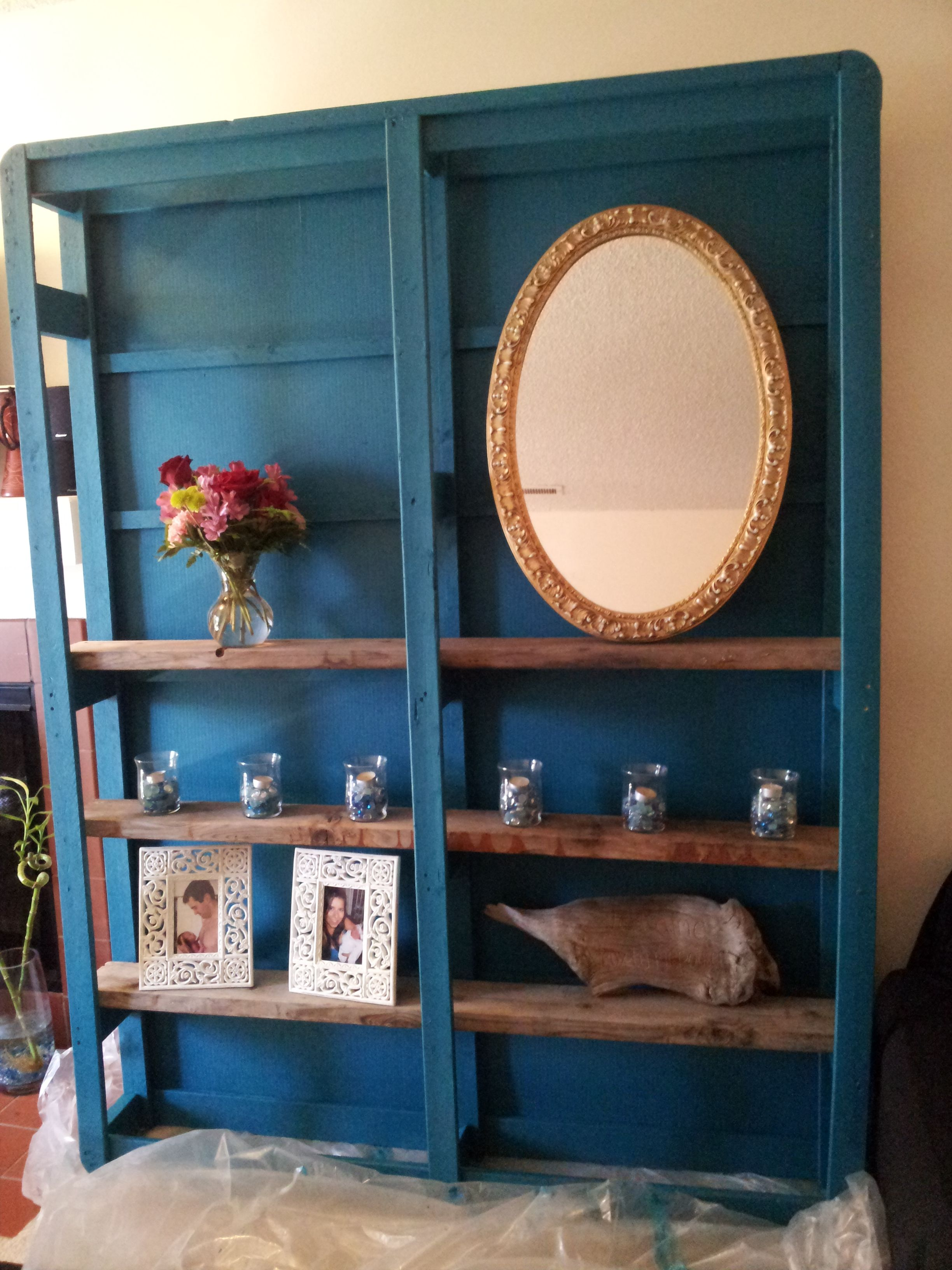 this shelving unit was made from the box spring of an old bed they
