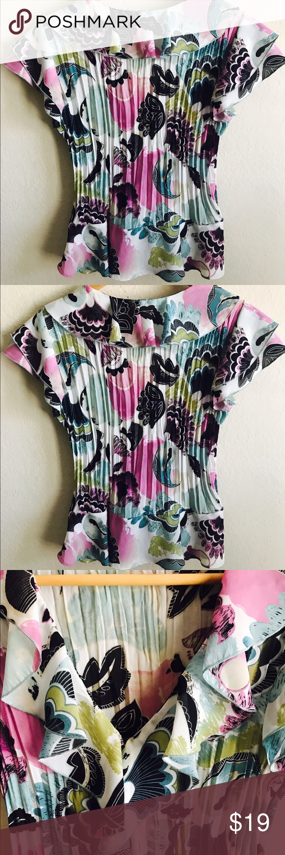 Sunny Leigh Floral Print Colorful  top Small. Sunny Leigh Floral Print Colorful Ruffle Crinkle Top Blouse sz Small.   Measurements:  Underarm to underarm: 19 Inches Length: 23 Inches   Thank you for visiting us, Please take a look at our other great items! Sunny Leigh Tops Button Down Shirts