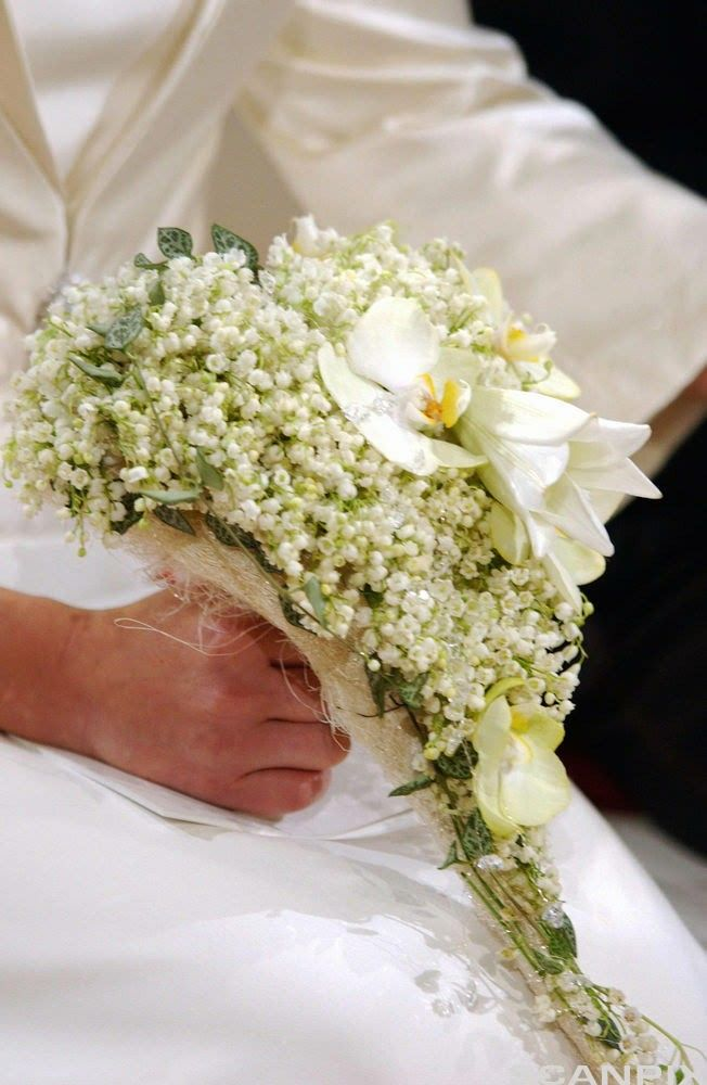Cascading Wedding Bouquet Showcasing White Lily Of The Valley Lilies Dendrobium