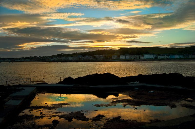 Another stunning sunset over #Millport taken at the old seawater paddling pool and boating pond at Kames Bay by Karen Brodie Photography.