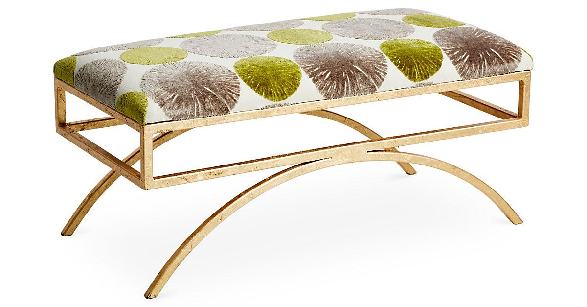 This luxurious modern bench features a sculptural steel frame and plush, cushioned seat. The patterned gold-and-silver upholstery pairs perfectly with the 18-karat gold leaf finish of the base....